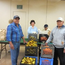 Volunteers at a Foodbank Brown Bag site help assemble grocery bags for seniors in need. Photo courtesy of Foodbank of Santa Barbara County