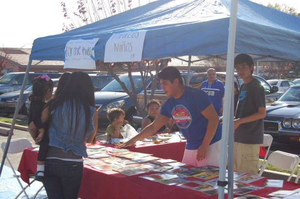 A patron browses an information booth during the first Santa Barbara County Cooperatives Festival on Nov. 8 in Lompoc.